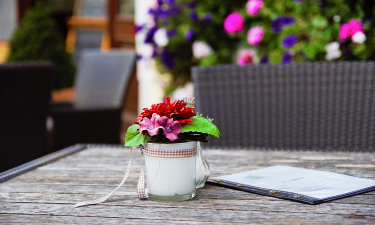 colourful-flowers-sitting-on-a-wood-table-on-a-custome-edmonton-deck