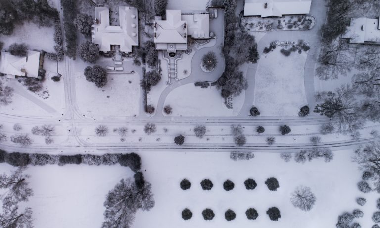 areal-view-of-snowey-homes-and-concrete-being-cared-for-in-the-winter-in-edmonton