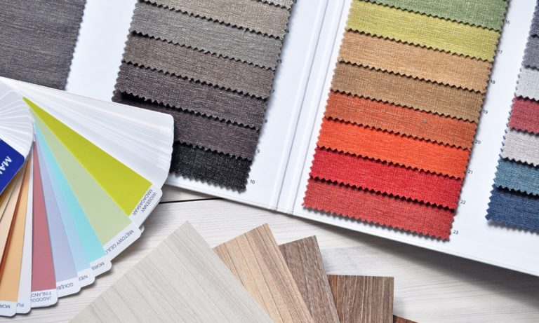 a-homeowner-using-paint-swatches-to-find-a-colour-to-paint-their-basement-post
