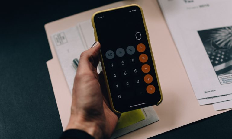 a-home-owner-calculating-their-reno-budget-using-an-iphone