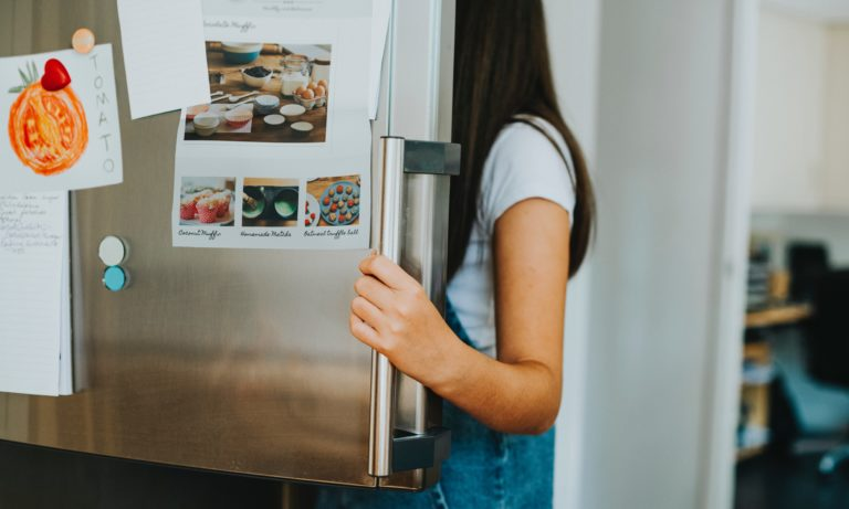 person-looking-into-an-edmonton-fridge-that-has-been-cleaned-under
