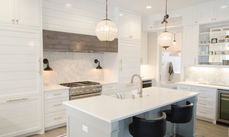 a-white-edmonton-kitchen-with-an-island-that-has-been-recently-renovated